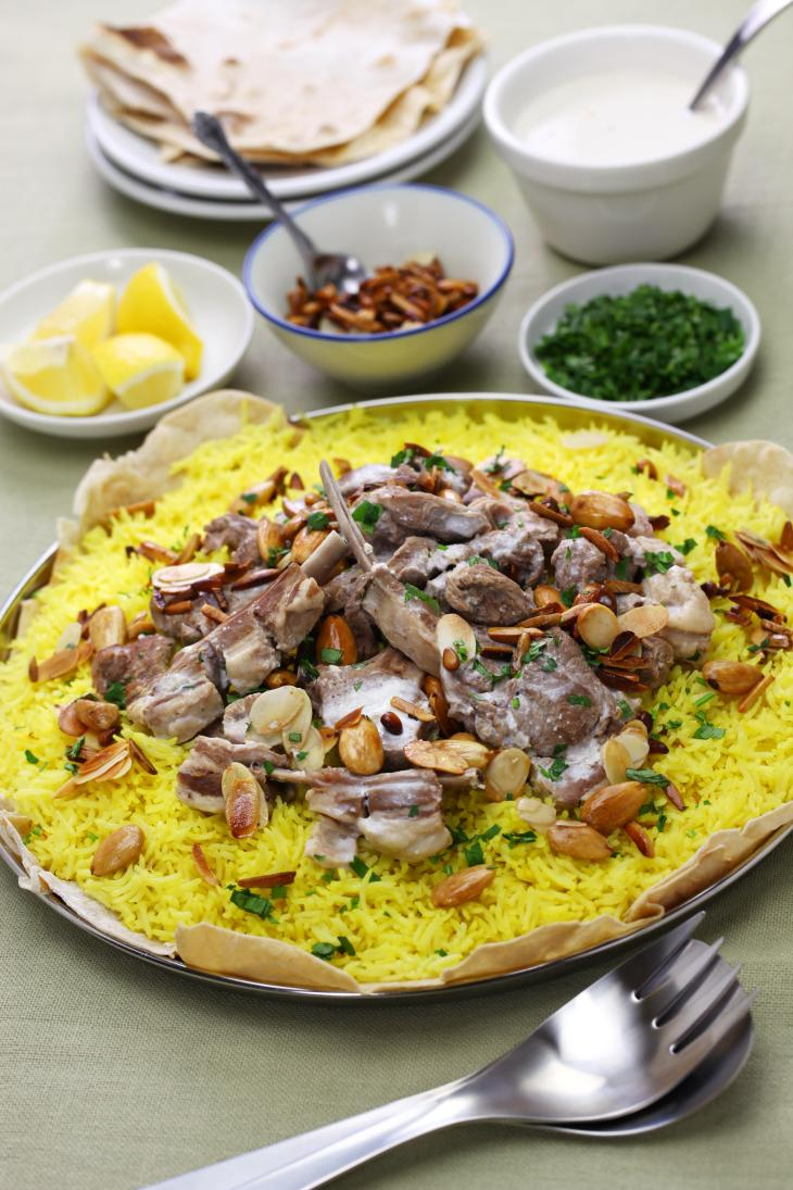 mansaf is a traditional Arab dish made of lamb cooked in a sauce of fermented dried yogurt and served with rice.